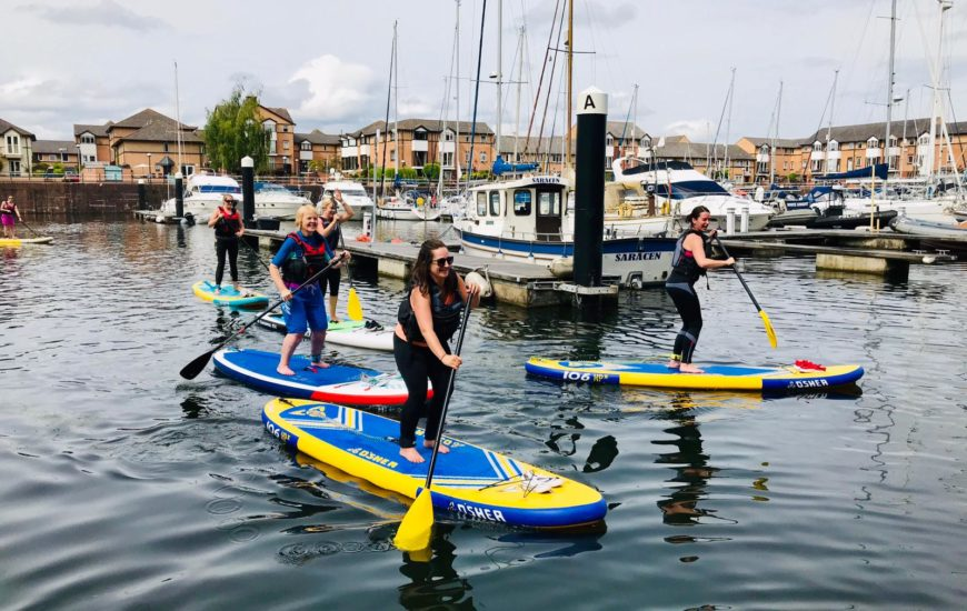 Women standup paddle boarding in Penarth, Cardiff