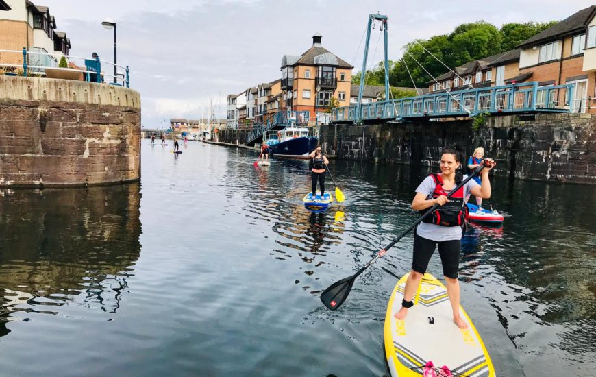 Women Standup Paddle Boarding in Penarth Marina, Cardiff