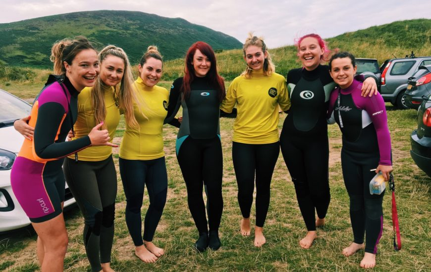 A group of women together in Llangenith, Gower after a social surf with Letzshare