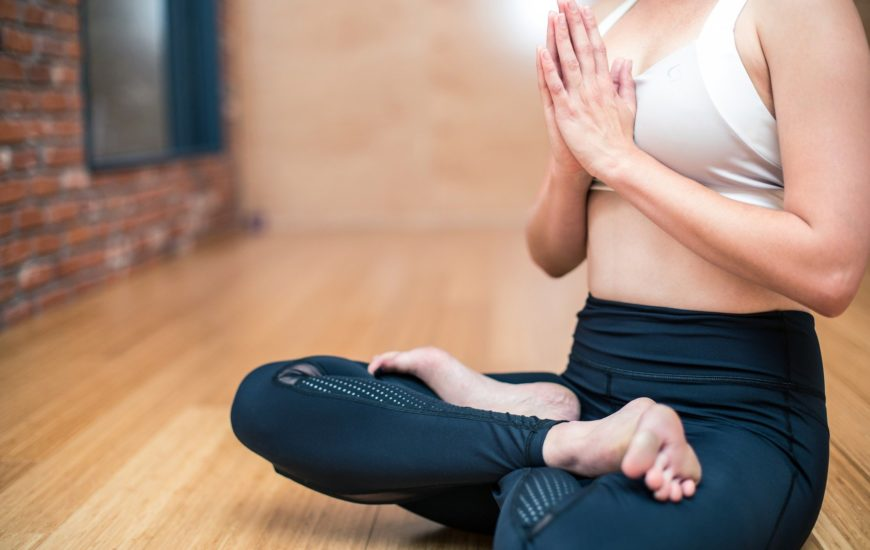 a woman in lotus pose