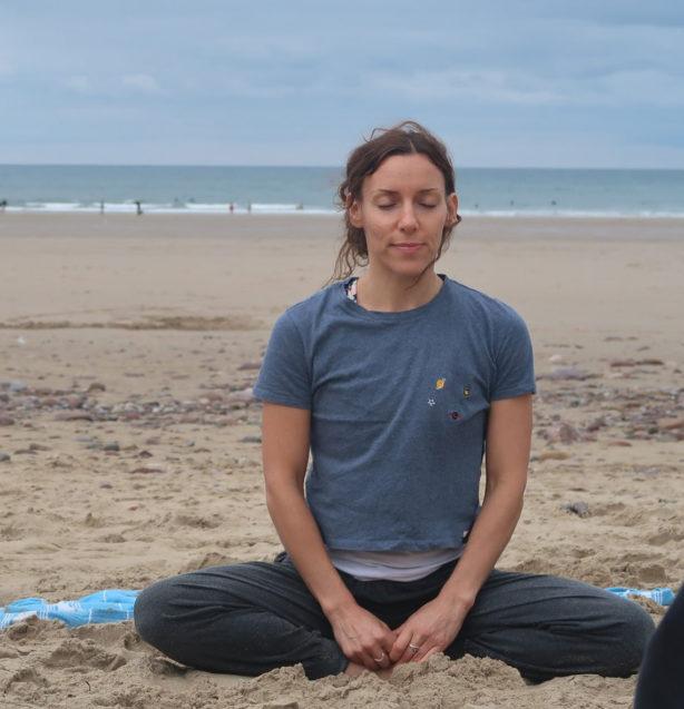 Ana Chidzoy during a yoga class on Llangenith Beach