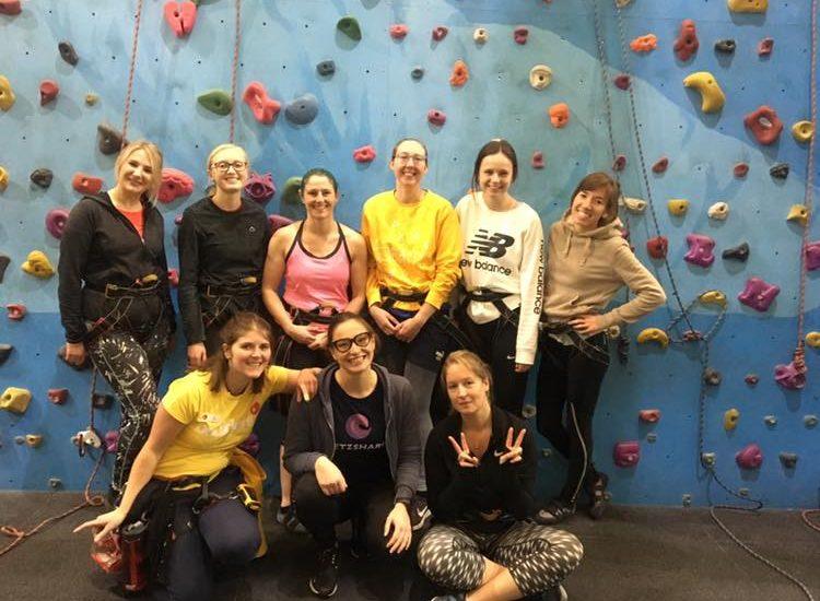 a group of women at a climbing centre